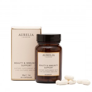 Aurelia London Beauty & Immunity Support Supplements. 60 capsules. Supplement Bottle with amber glass and black screw lid and box with a few capsules next to the bottle.
